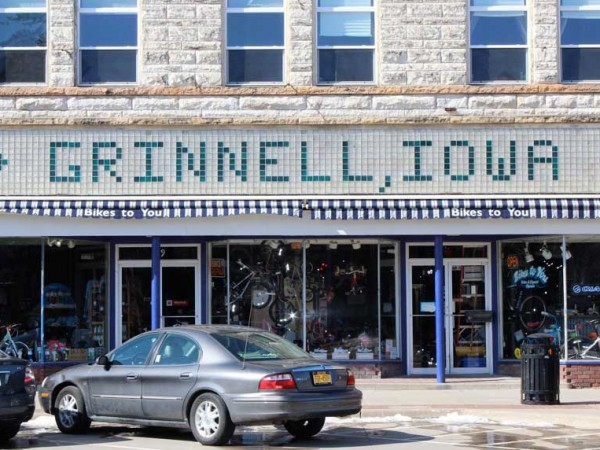Grinnell, Iowa spelled in building tiles in Downtown Grinnell