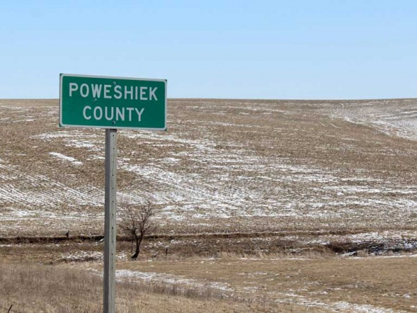 """Poweshiek County"" roadside sign"